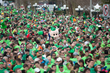 Downtown Pensacola becomes a sea of green during the McGuire's race