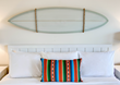 Custom-made surfboards hang over the beds at Laguna Beach House