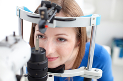 A woman undergoing an eye test