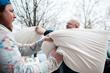 Start a pillow fight with a stranger
