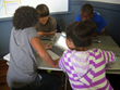 Students collaborate in a blended learning classroom