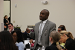 Cooley Law School Student Asks Guest Speakers Questions Durring An Open Forum Discussion