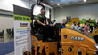 John Pond, owner of Forest City Paving in Rockford, Ill., sits atop the CASE DV26 roller he won in the CASE Construction equipment giveaway during National Pavement Expo 2015.