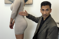 Dr. Dennis Dass shows a patient's results with her Brazilian Butt Lift