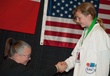 12 year old Sylvia Todd accepts her bronze medal