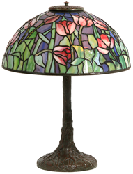 A strong candidate for top lot of the auction promises to be a Tiffany Studios Tulip table lamp with domical shade having a background with wonderful blue translucent hammered textured glass with hints of purple, red and opaque striated tulip flowers, sur