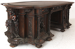 Lot 126: An expected star lot of the furniture category is this walnut marble-top partner's desk and chair.