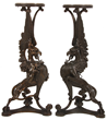 Lot 213: Pair of figural winged griffin pedestals depicting bird-like head and lion's body, 42 ½ inches tall.