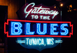 The neon sign at the entrance of the Gateway to the Blues Museum