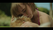 Still from the 30-second TV ad depicting the reunion of Emma and Biscuit