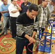 Attendees testing the EZ Turn™ Anti-Blowback Hoses.