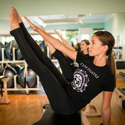 Club Pilates Teacher Demonstrating on Pilates EXO Chair