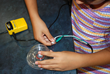 Wire, a magnet, and a lid become an educational engineering model.