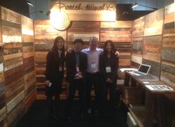 William Beleck, head of Nichibi Global, hosts the Pioneer Millworks reclaimed wood booth in Japan.