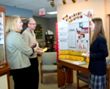 Hannah, an Everest Academy student, prepares for the Science Fair regional competition by discussing her winning project with Homer Township Vision Center