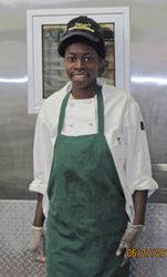 Photo of Latoya Bristor, who has a disability, at her job at Wright's Gourmet Deli in Tampa, FL