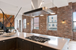 Thin brick tile use as an accent wall makes a strong statement in this industrial space.