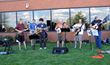 The Flower Hill String Band plays bluegrass music at the 2014 Face of America ride.