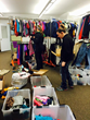 Clickstop employees sort through donations collected during the company's first Donation Drive for Clickstop Cares.