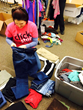 A Clickstop employee sorts through donations for the Clickstop Cares Closet.