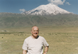 Robert Aram Kaloosdian standing in front of Mount Ararat in 1999. photo by Carolyn Mugar