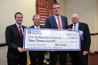 Florida Hospital Tampa's President Brian Adams presents donation to Rotary Club of Tampa