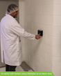 An Aphria staff member using a Suprema BioStation on an interior door.