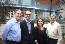 SIGNiX's leadership team poses in front of Warehouse Row, the location of its new office space