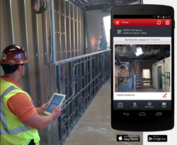 Construction worker using RedTeam construction project management software on a tablet