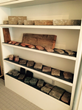 Reclaimed stone and brick sample selection on display.