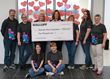 The Balluff Heart Mini Team displaying the $1000 donation check from Balluff's President Kent Howard.