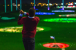 Golfer swings at Topgolf