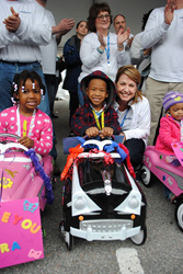 Saint John's Preschool receiving their pedal cars.