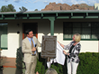 Historic Site Marker at L. Ron Hubbard House at Camelback is unveiled by Ben Davis, Friends of L. Ron Hubbard Foundation, and Dr. Anne Woosley, Executive Director of the Arizona Historical Society.