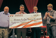 Harvey's president, Jim Barreira, presents $31,000 to Homes for Our Troops