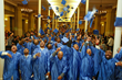 Graduates of The Doe Fund's Ready, Willing & Able transitional work program toss their caps in celebration