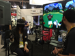 A fan wearing the Perception Neuron glove tries out a VR game during GDC 2015.