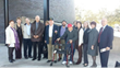 Pastor Bittner, fourth from left, with  survivor Sigmund Jucker of Three Brothers Bakery,liberators, descendants, local leaders  and staff at the Holocaust Museum