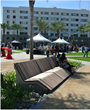 Civitas custom-designed chaise lounge-style benches of  Ipe and stainless steel for relaxing at the new park.