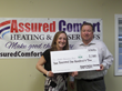 Assured Comfort owner Jerry with Lynn Cole, Chair, Education Funding Partners.