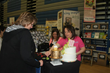 Deborah Coughlin assists a customer at the show booth