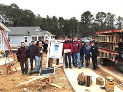Volunteers from SignatureFD and Charles Schwab help build a Habitat for Humanity home in February.