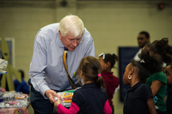 Goodwill Community Foundation president Dennis McLain shares school kits with Durham students in need.