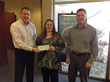 INS check presentation by Kent Atha and Daryl Carlson to Judy Harvey