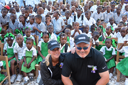 Renee and Bob Parsons Visit with Haitian Students