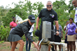 Renee and Bob Parsons Test New Wells at Haitian Schools