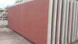 Stamped brick exterior: Such sound walls are often exposed to harsh environmental conditions dividing interstates and communities. PENETRON ADMIX's crystalline technology protects the walls from salt