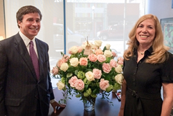 Judy Turner is presented with 50 roses by Charlie Crawford as she marks 50 years in banking.