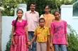 Shruthi (left) and her siblings, Vinay and Sony, pose for a picture with their parents, Venkat and Shoba in India.