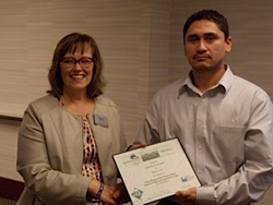 Dawn Bluemke (BDC) presents Kevin Cruz with his course completion certificate